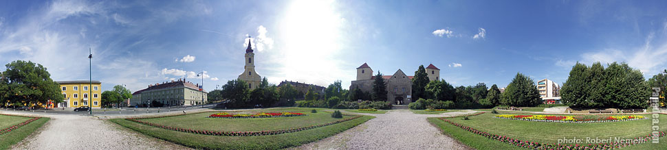 Thury Castle and the roman catholic church - Várpalota, Hungary - Panorama photo (panoramic image)